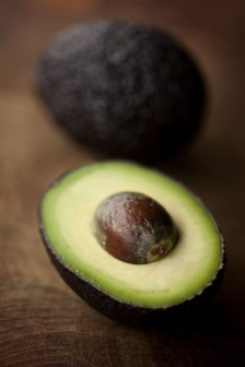 Close-up of fresh sliced avocado on wooden table
